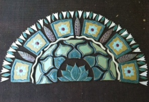 Just taken out of the kiln.  A tile rug I worked on while teaching class.  Not framed or grouted yet!