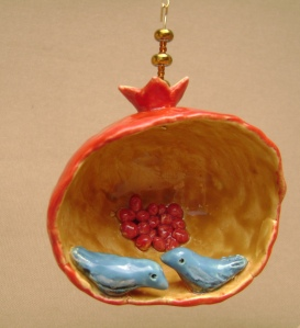Blue birds in a  ceramic pomegranate ornament
