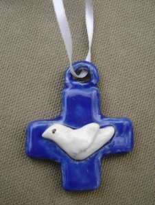 Mini blue chunky cross with a dove