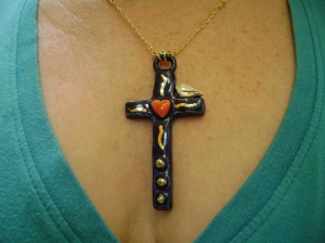 Mini blue cross with heart and tiny sitting bird pendant