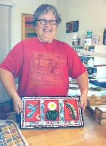 Proud Karyn with her trio tile mosaic wall piece!