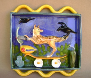 Coyote on a Scooter with Menacing Crows. Ceramic Shadow box