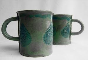2 Coffee Cups in teal and muted turquoise, with tear drop stamp design