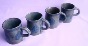 Coffee Cups with teal and muted turquoise glaze.