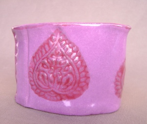Fuchia mini creamer, with  deep red tear drop stamped design.